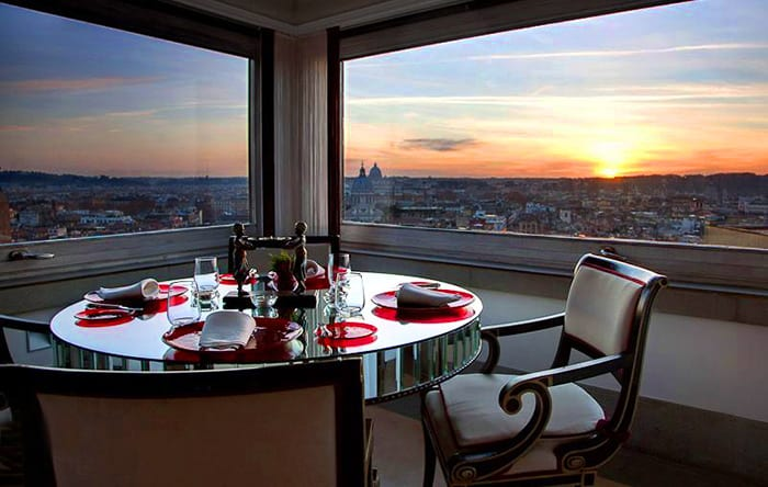 Romantic dinner table in the restaurant, with incredible view over rome during sunset