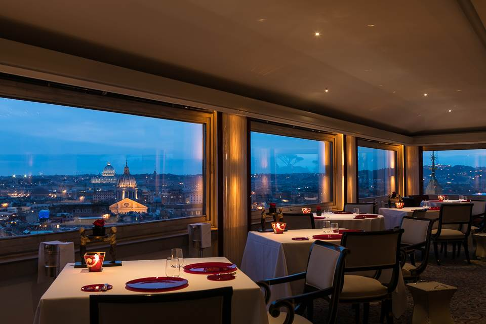 Night view of the restaurant, huge glass windows with incredible view over the eternal city