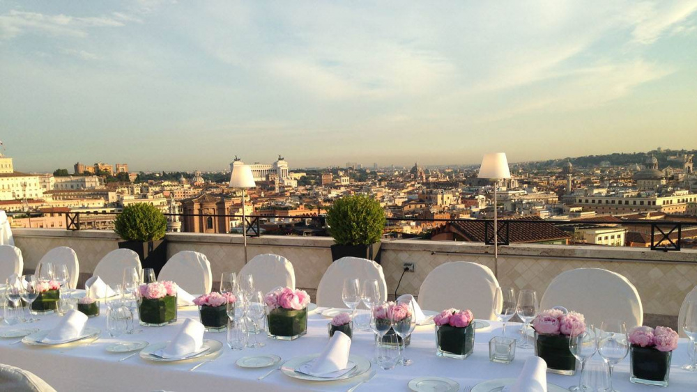 Terrace wedding set-up lunch with fresh flower's centerpieces with panoramic view over rome