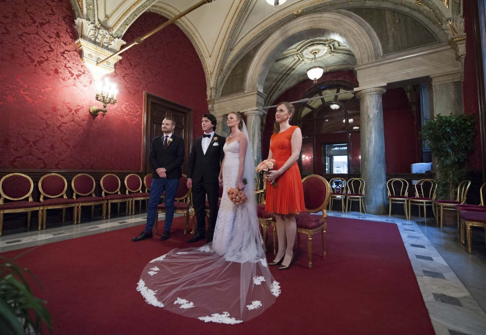 Bride, groom and two witnesses in Red wedding Hall in Campidoglio