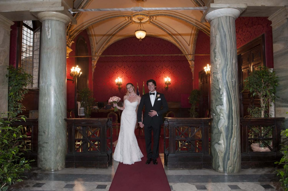 Bride and groom just married at the exit from the Red Hall in Campidoglio Rome