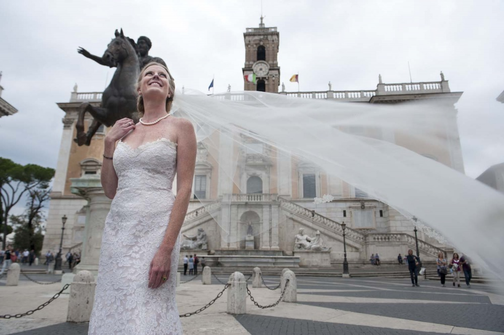 Bride with long veil in front of Campidoglio, Rome
