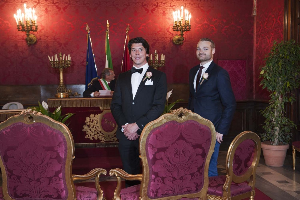 Groom and the witness waiting for the bride in the Red Hall in Rome