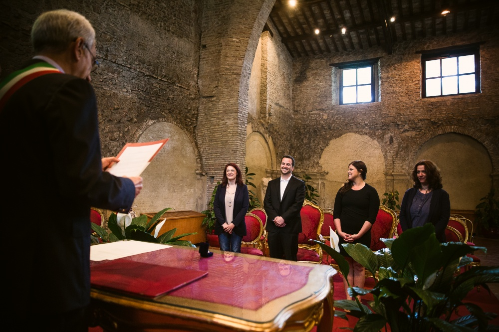 Ceremony celebrant with the couple and witnesses during a ceremony in Rome