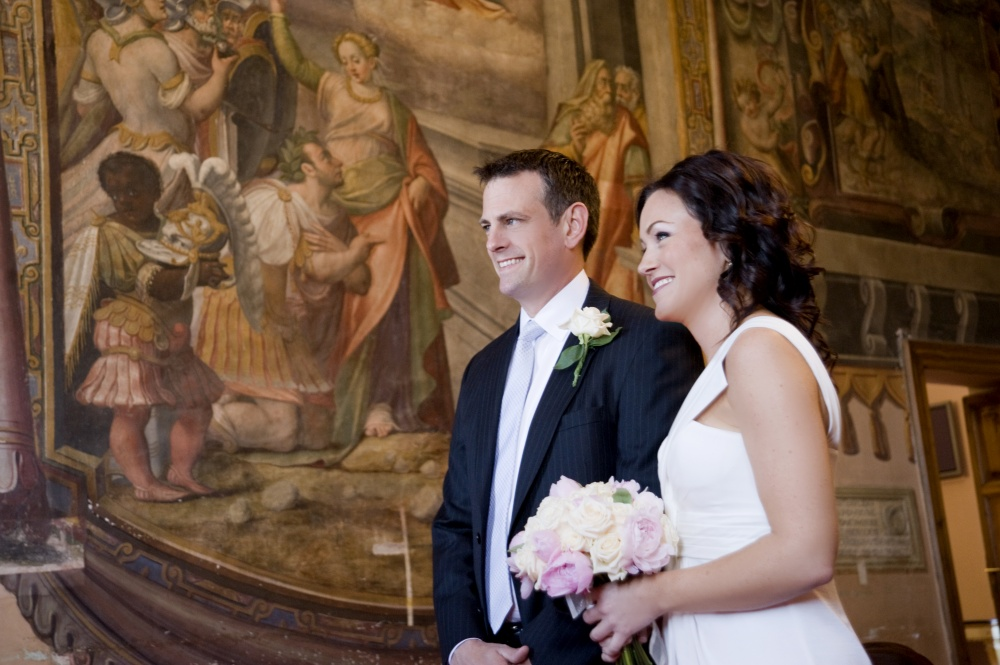 Wedding moment with bride and groom during their ceremony in Tivoli's hall in Rome
