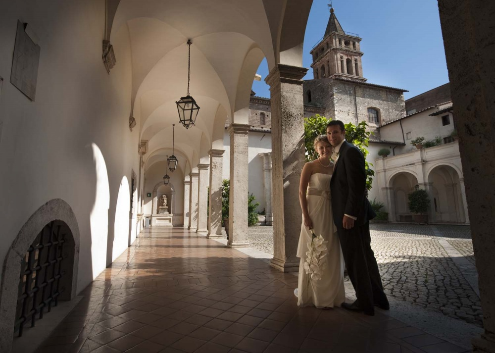 Bride and groom in a cloister in Tivoli Rome after wedding ceremony