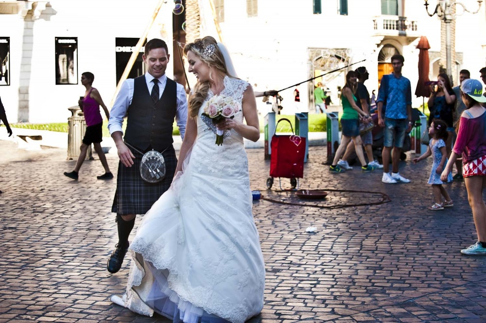 Bride and groom walking in Rome with tourists