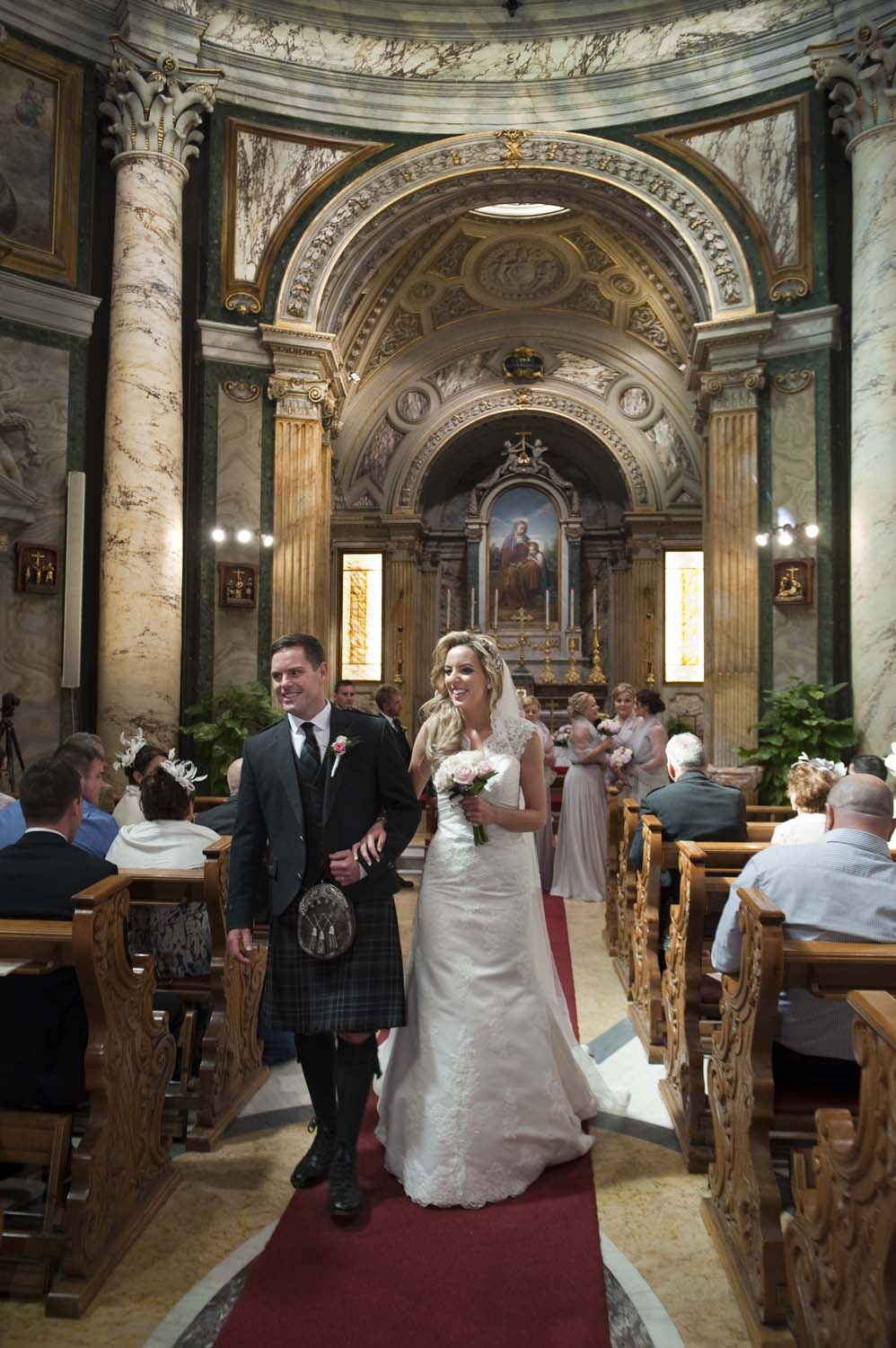 Bride and groom exit from the Church in Vatican, Rome