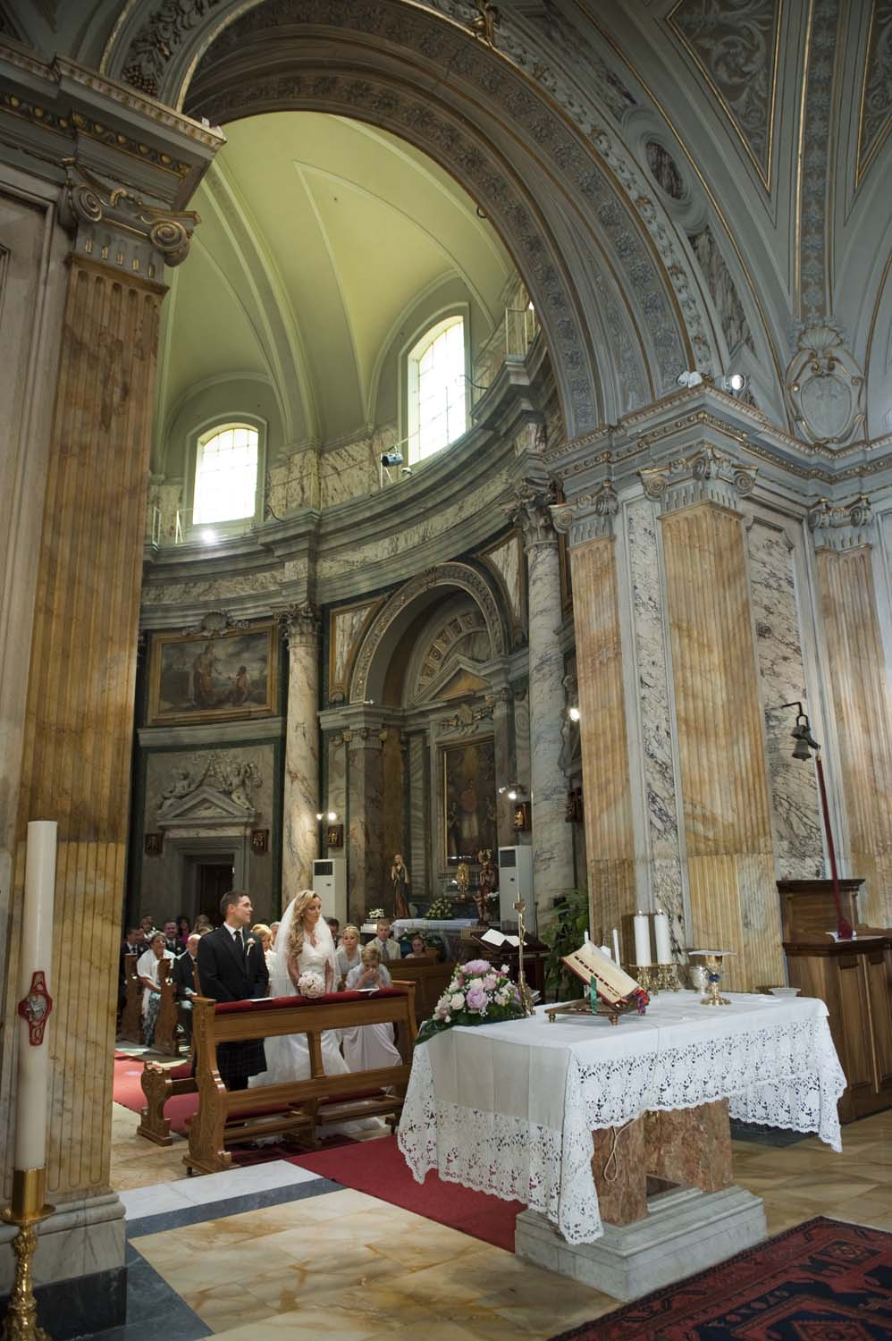 Catholic wedding ceremony in a baroque church in Vatican Rome