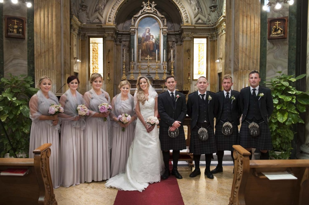 Bridesmaids and groomsmen in a portrait in the church in Rome