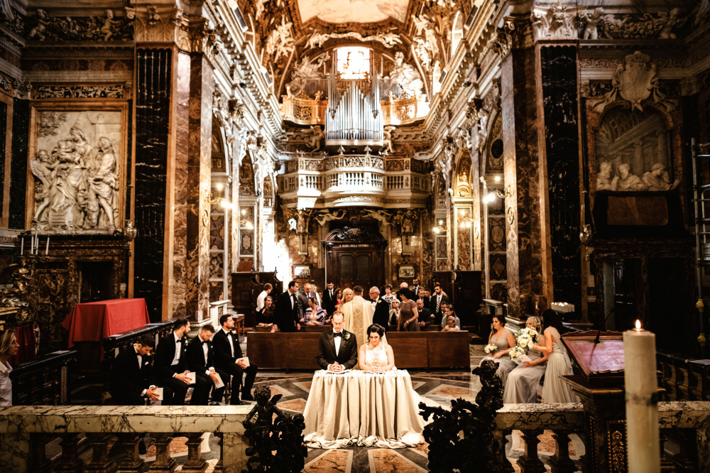 View from altar during catholic wedding ceremony in a beautiful baroque-style church in Rome