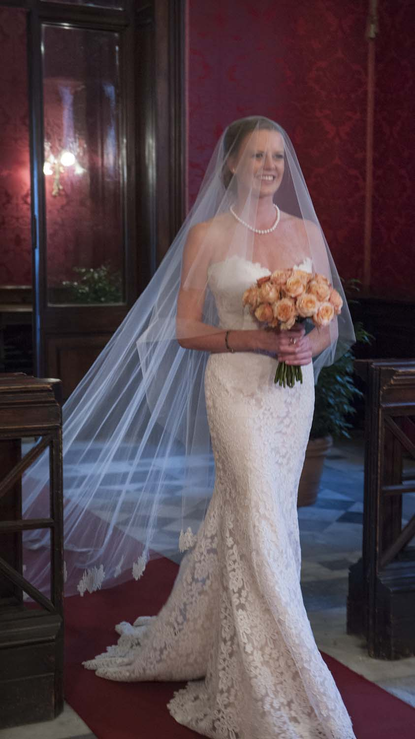 a beautiful bride entering the red hall for her unforgettable elopement at the red hall in Rome