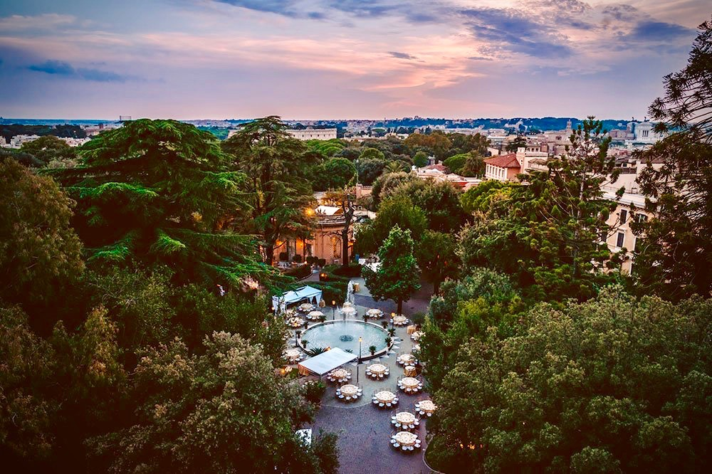 an aerial view of the verdant park of the palace in amanzing destinatio location in rome
