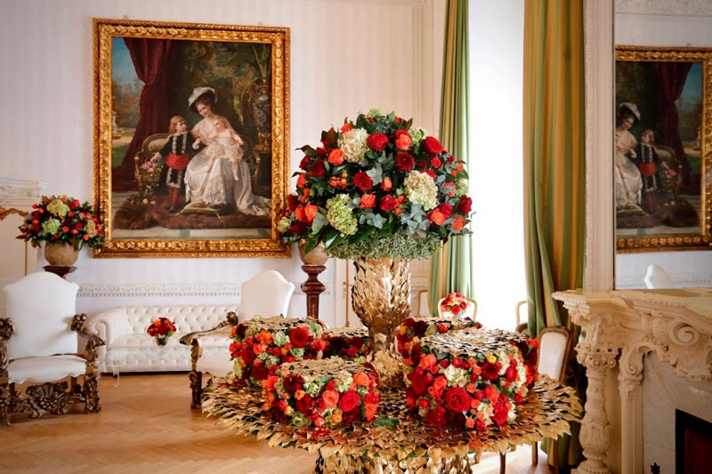 A colourful flower details with beautiful red and white flowers in elegant wedding hall entrance