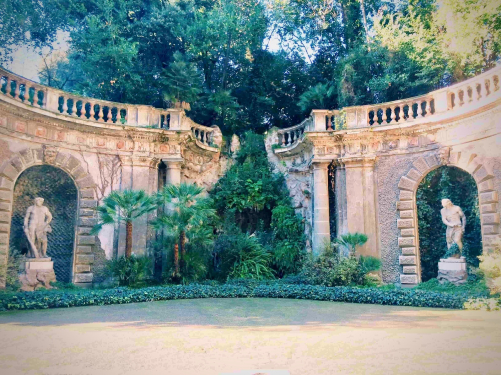 a picture of the beautiful ninpheum sculpture set in the verdant gardens of wedding palace rome