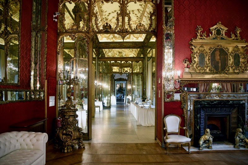 A rich adorned and fine decorated entrance of wedding hall with fabulous antique forniture