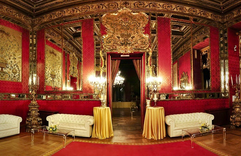 details of furniture, rede velvet walls and mirrors in sumptuous hall for weddings in Rome