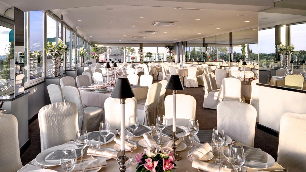crystal lounge elegant wedding set up all white tablecloth and chairs fresh pink roses centerpieces