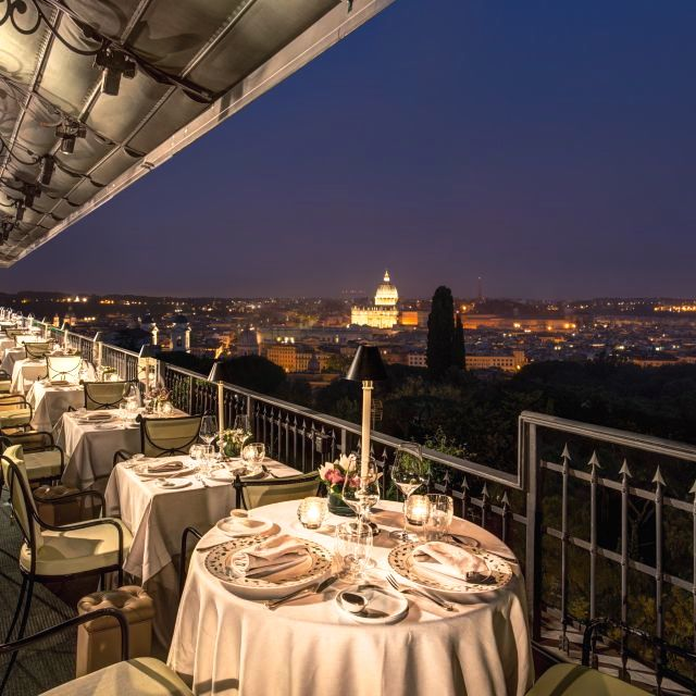 Elegant dining on the terrace overloonking St Peter by night for romantic open air for wedding