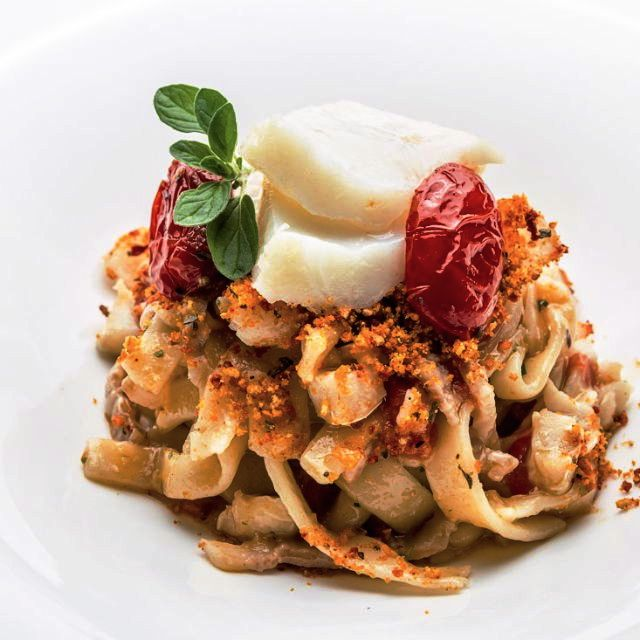 detail of michelin star gourmet handmade tagliatelle codfish and tomato great option for weddings