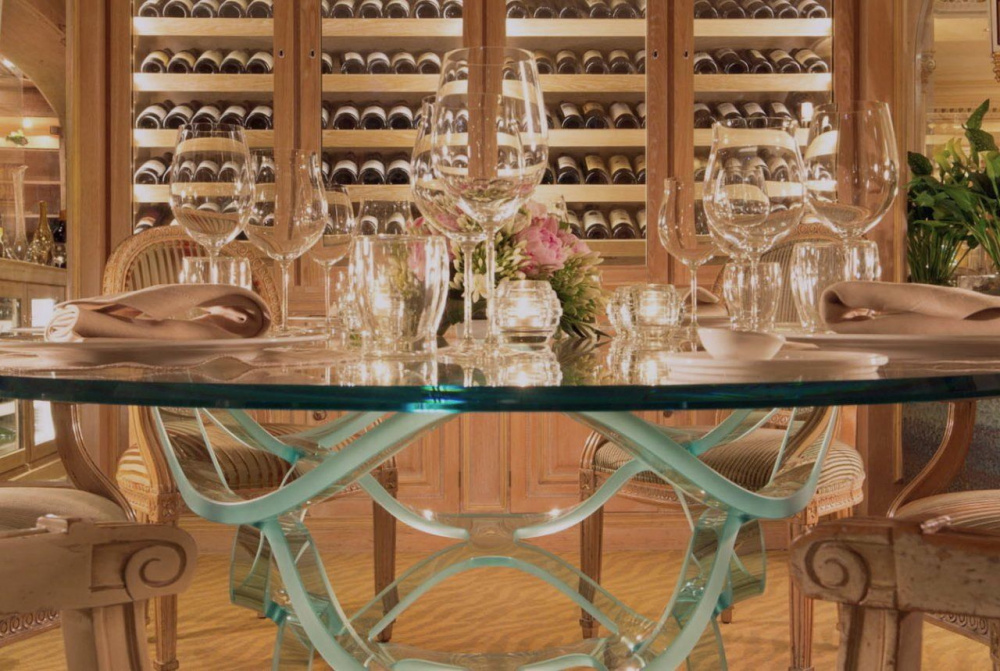 wine cellar detail of impressive crystal table dinner set up with fresh flowers for intimate wedding
