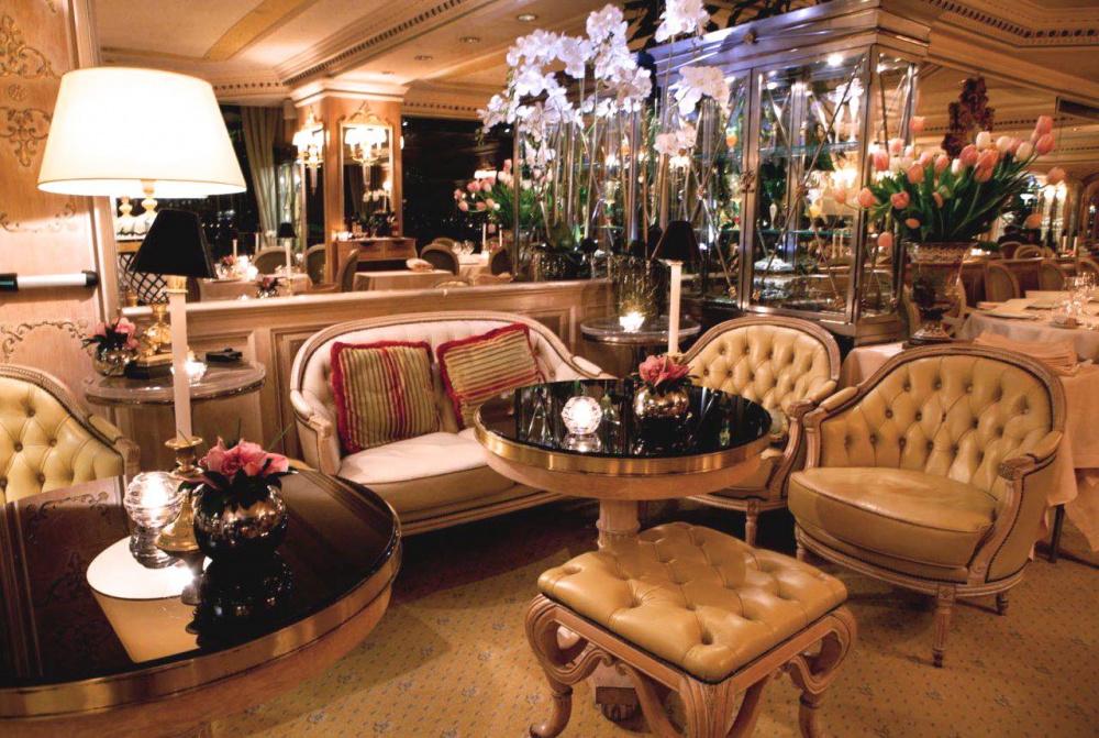 elegant lounge bar area with fresh flowers elegant armchairs soft lights