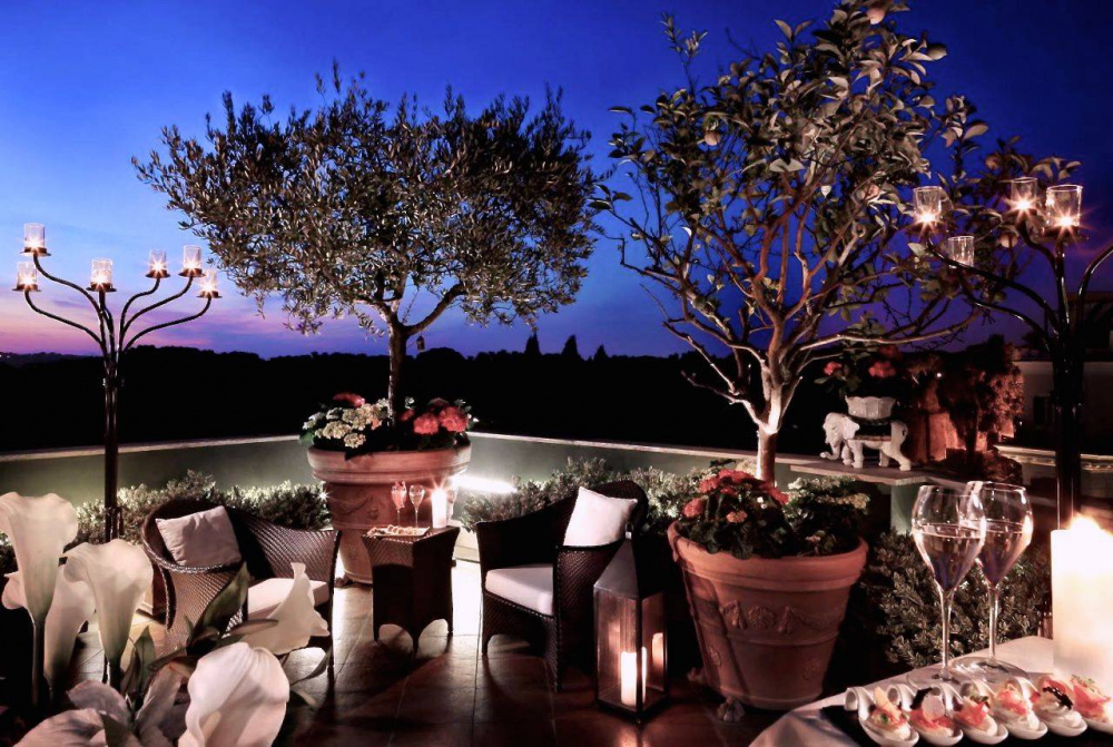 stylish roof top terrace loung bar by night with view