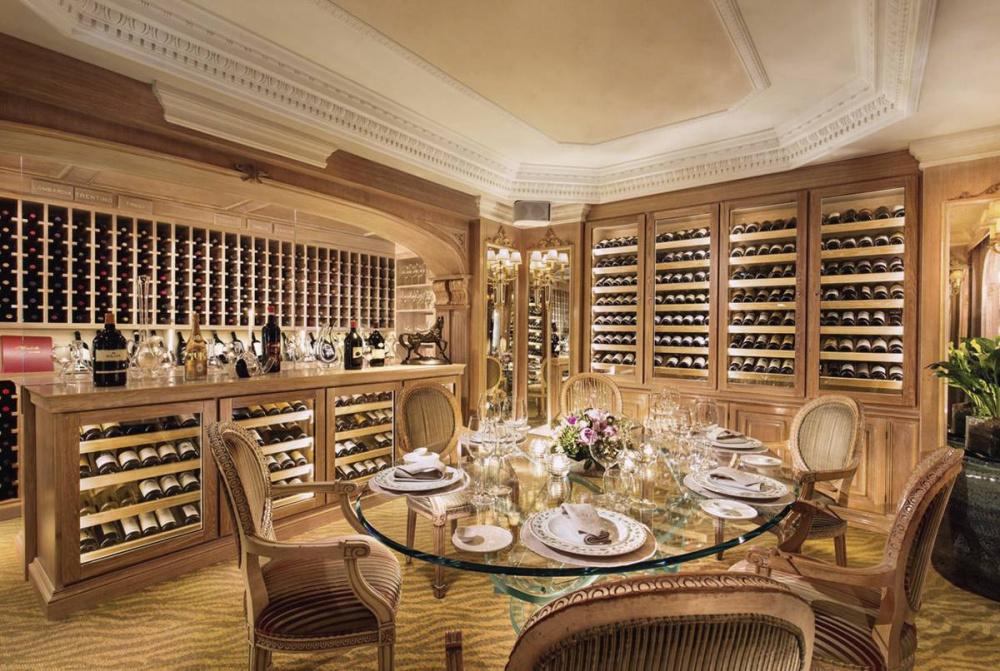 elegant dinner setup in wine cellar unique crystal table anf fresh flowers initmate weddings only