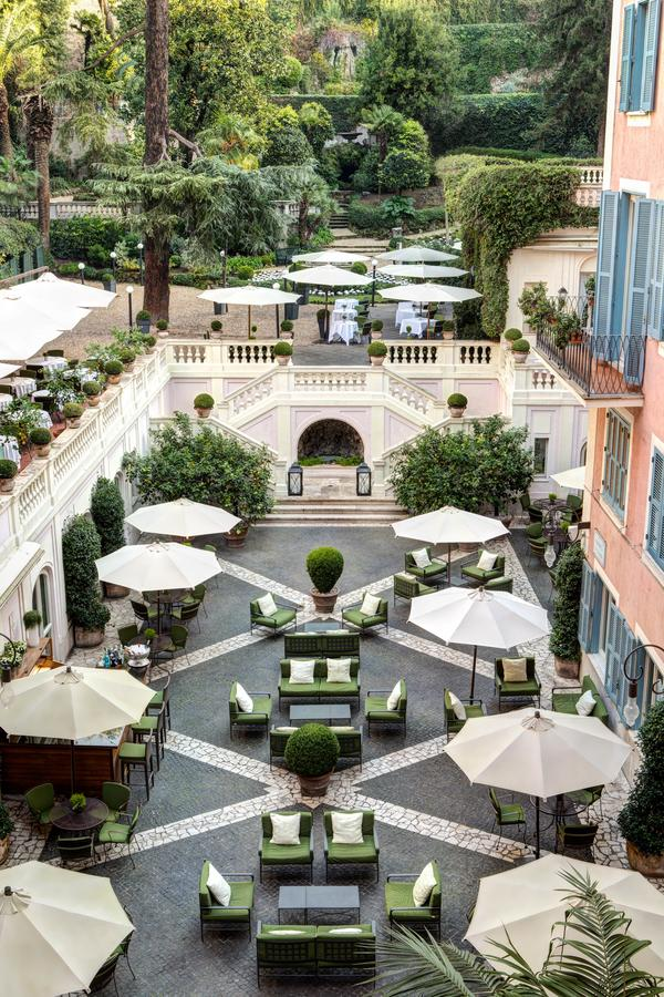 Courtyard with lounge area surrounded by a terrace and gardens in Rome for wedding receptions