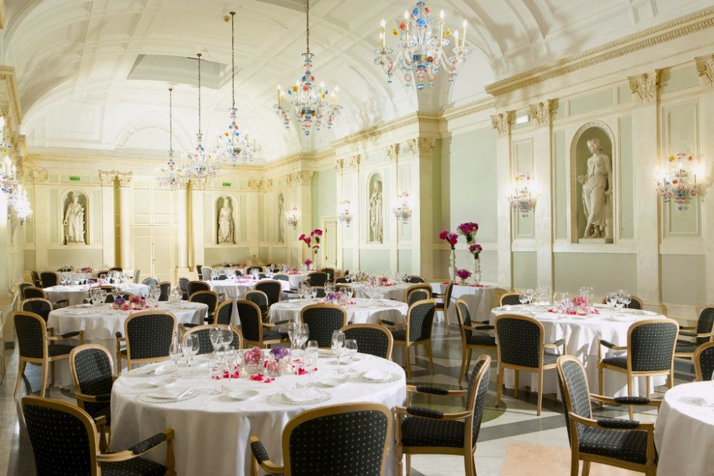Elegant Ballrooom with murano glass chandeliers and marble sculpures perfect for wedding dinners