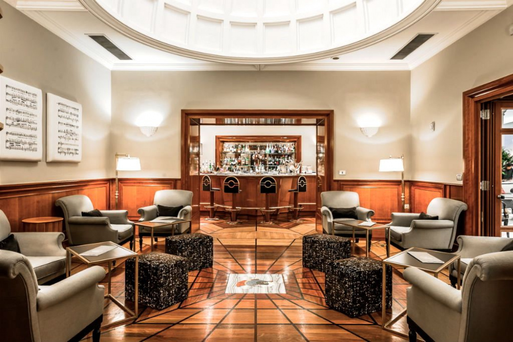 Stylish luxury wedding hotel's lounge bar with elegant and confy armchairs and finely decorated