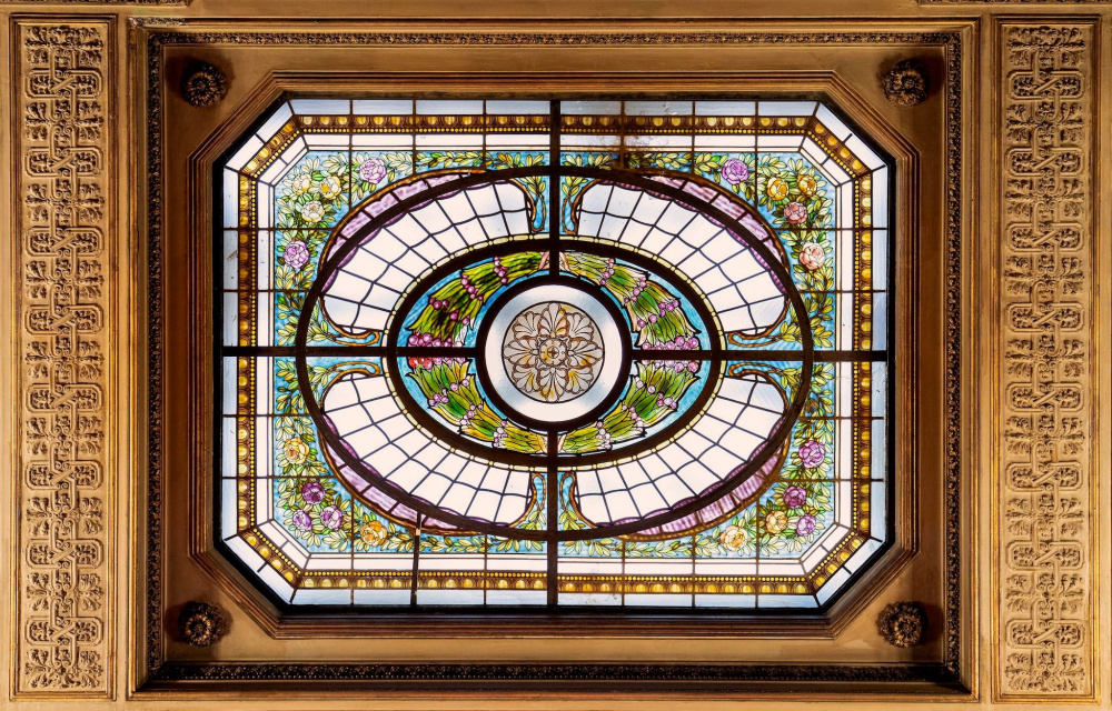 detail of a liberty style stained glass roof window