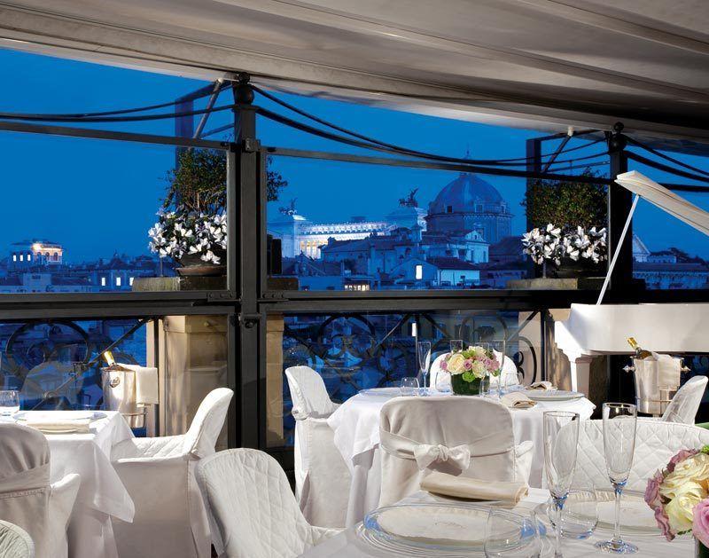 dinner in luxury wedding restaurant with fantastic view over main monuments in Rome
