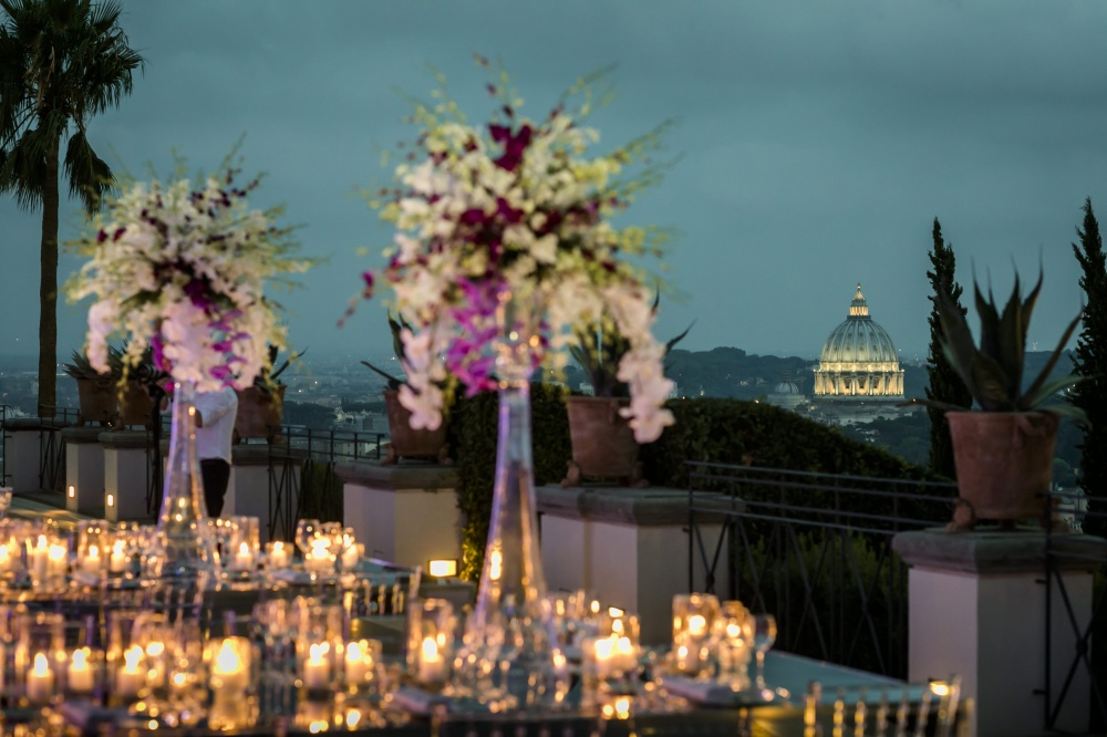 Wedding decor with orchids, candles and mirror tables