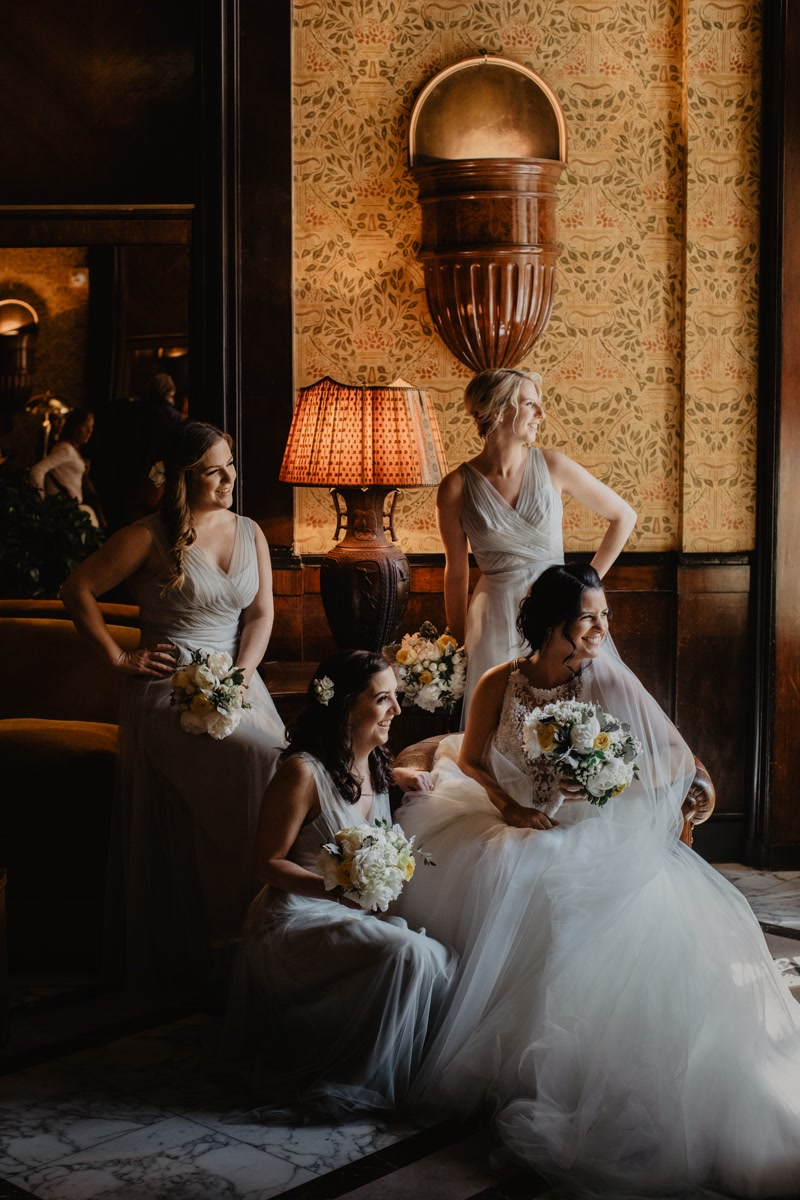 Bride and bridesmaids in a portrait at the hotel lobby