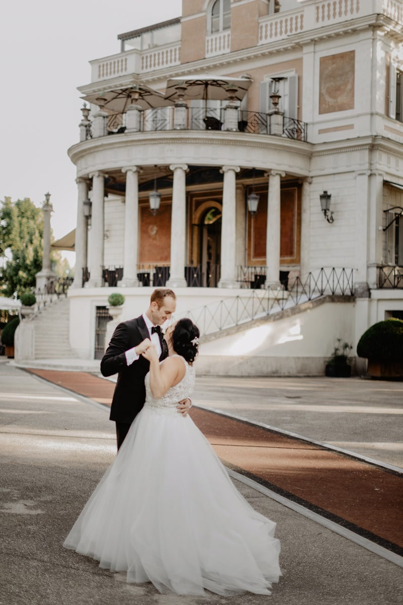 Bride and groom dancing in front of a villa in Rome