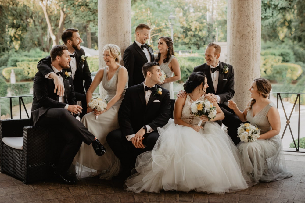 Bride, groom, groomsmen and bridemaids in a portrait