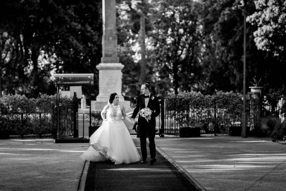 bride and groom at the entrance of the wedding venue