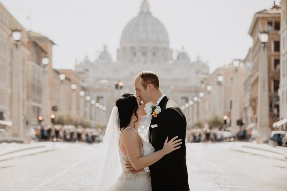 Groom kisses the bride in Vatican Rome