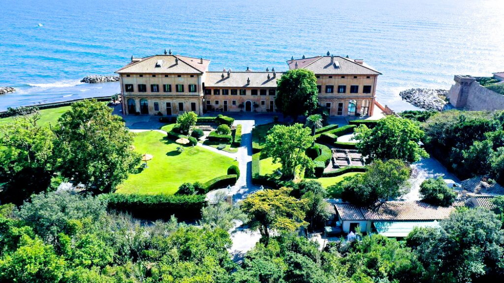 Aerial view wedding villa touched by tyrreanean sea and surrounded by mediteranean gardens