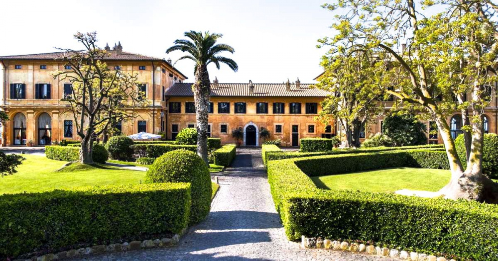 main entrance romantic renaissance wedding villa by the coast near Rome surrounded by gardens