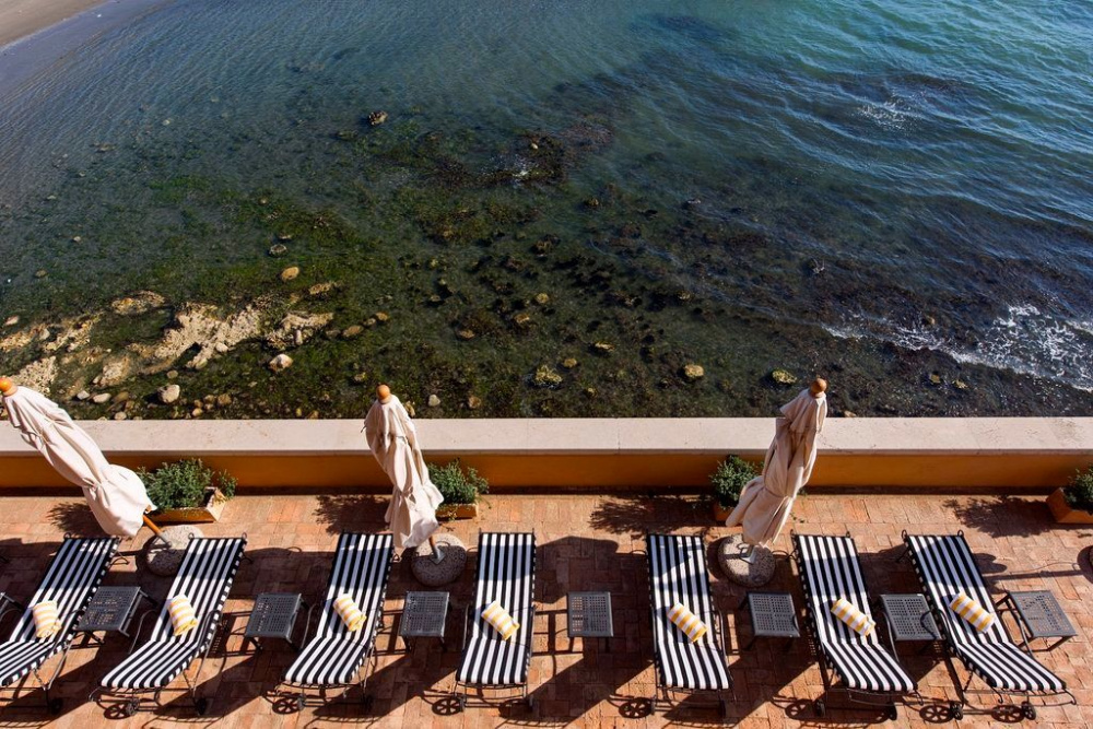 sun bath area over the sea for your relax moment before or after your dream the wedding