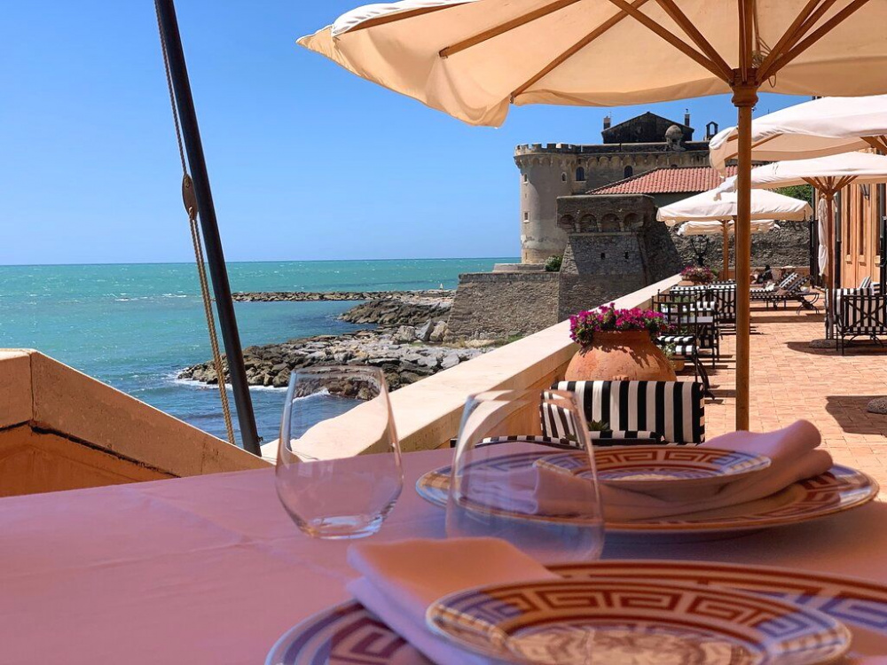 detail of the view from one of the restaurant's lunch table over the sea and old castle on the back