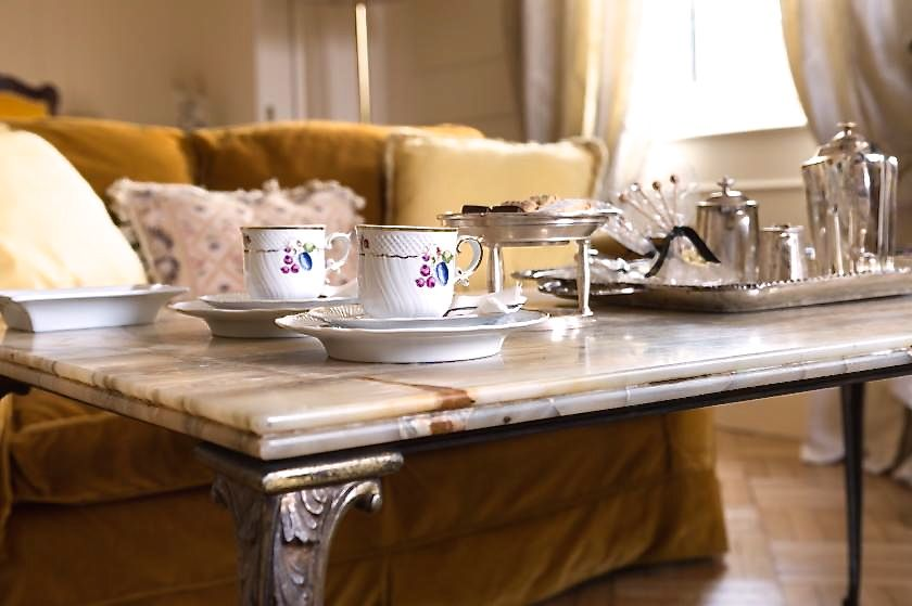 detail of elegant tea time set-up in a marble table