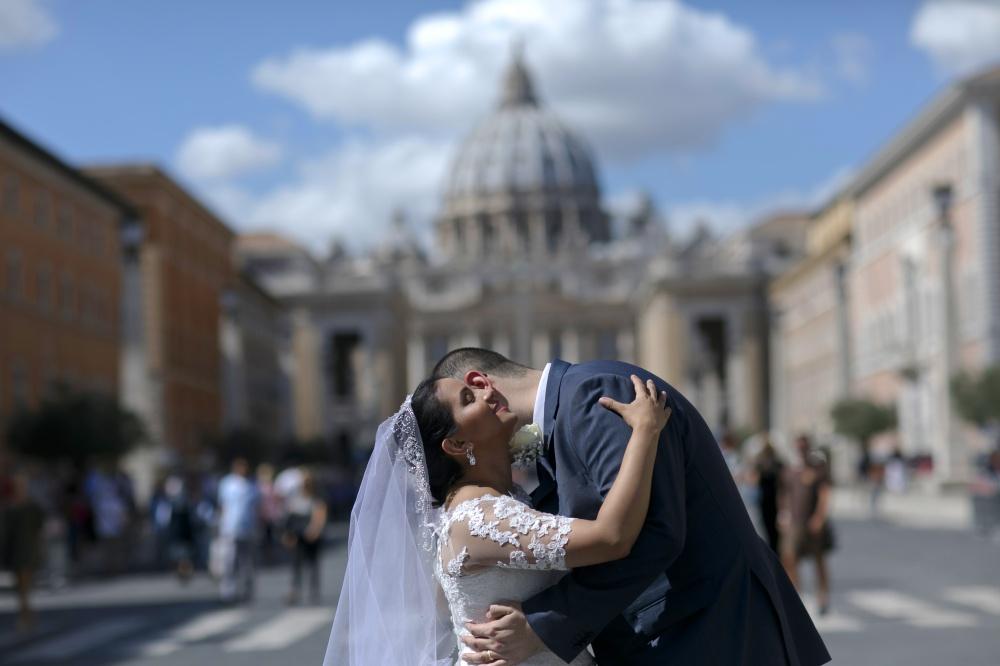 Bride and groom in a romantic hug in Vatican Rome
