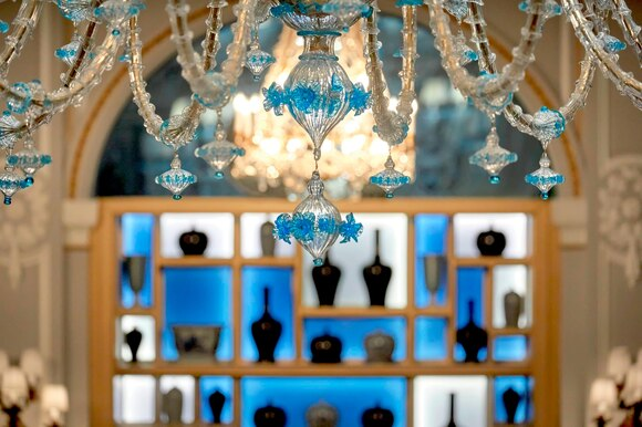 detail of the impressive murano glass with fine decorations in blu colour